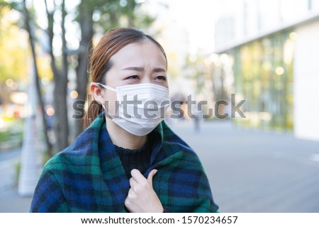 japanese woman wears white mask #1570234657