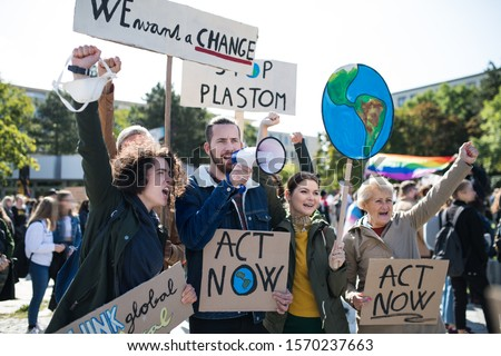 People with placards and amplifier on global strike for climate change. Royalty-Free Stock Photo #1570237663