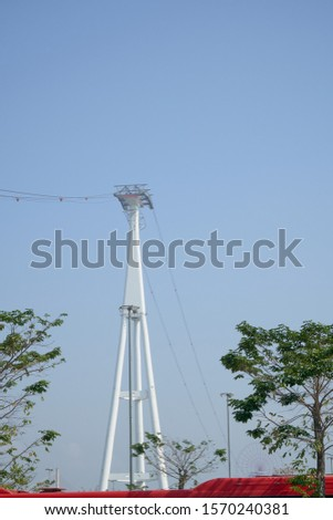 Cable Car Transportation Ropeway Pole in the Amusement Park Near the Beach #1570240381
