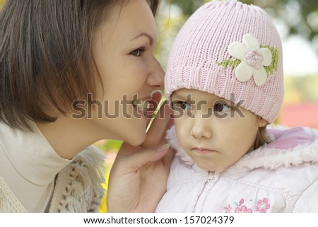 portrait of a beautiful mother and a little girl in the autumn #157024379