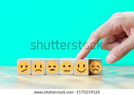 Businessman chooses a happy emoticon icons face.  Service, communication concept #1570254526