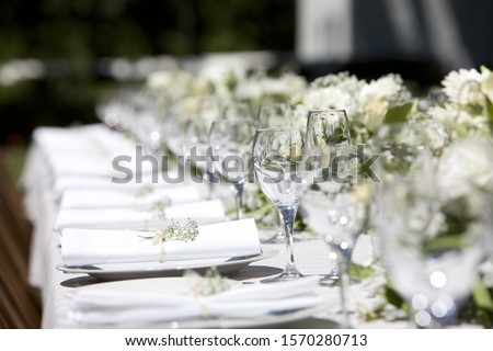 Row of place settings on table for a wedding reception #1570280713