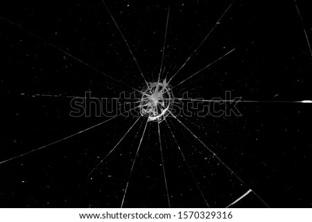 Abstract broken glass texture on a black background. Cracked black glass