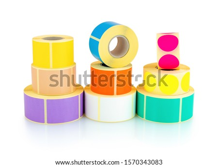 Colored square and circle label rolls isolated on white background with shadow reflection - clipping path. Color reels of labels for printers. Labels for direct thermal or thermal transfer printing. #1570343083