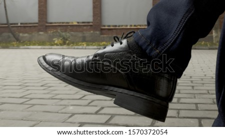 male foot with male boot #1570372054