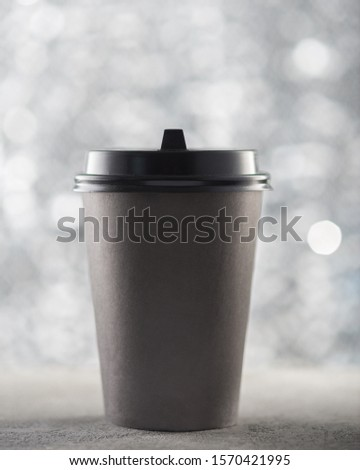 Paper cup of coffee, festive Christmas background, beautiful blurred bokeh, place for text logo #1570421995