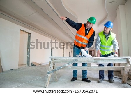 Construction worker during interior decoration, copy space #1570542871