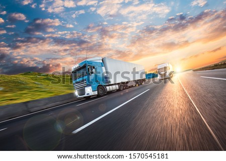 Truck with container on highway, cargo transportation concept. Shaving effect. #1570545181