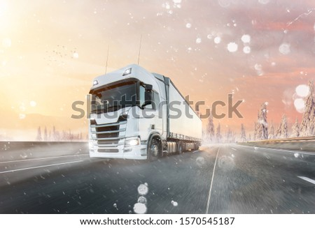 Truck with container on winter highway, cargo transportation concept. Shaving effect. #1570545187