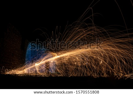 Steel wool photography. Long exposure. Light painting. Fireworks in night time.