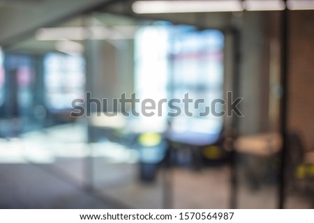 Atmosphere around office blur background with bokeh. Abstract blurred office interior room. blurry working space with defocused effect. use for background or backdrop in business concept Royalty-Free Stock Photo #1570564987
