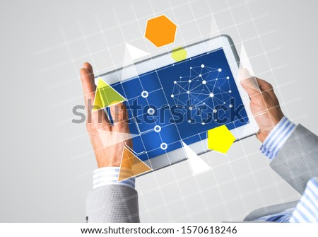 Close of businessman hands holding tablet pc with infographs on screen #1570618246