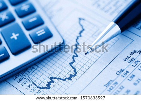 black pen and calculator on business graphs of stock and forex trends #1570633597