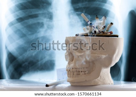 concept of the dangers of smoking cigarettes, the danger of cigarette smoke to humans, copy space #1570661134