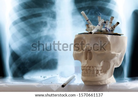 concept of the dangers of smoking cigarettes, the danger of cigarette smoke to humans, copy space #1570661137
