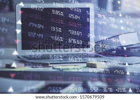 Forex market chart hologram and personal computer background. Double exposure. Concept of investment. #1570679509