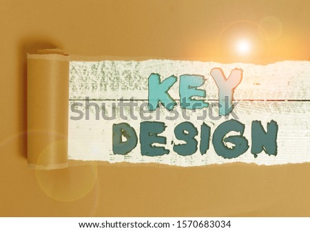 Word writing text Key Design. Business concept for a necessary or very important realization of a concept or idea Cardboard which is torn in the middle placed above a wooden classic table. #1570683034