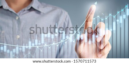 Businessman plan graph growth and increase of chart positive indicators in his business #1570711573