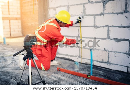 Technician with Laser measurement level during work #1570719454