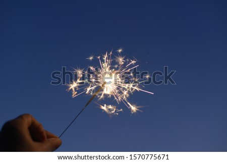 Abstract image of sparkler firework burning light in hand. #1570775671