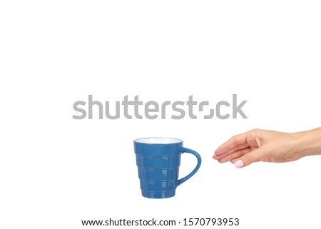 Hand with blue ceramic cup, mug for coffee and tea, kitchen pottery. Isolated on white background. Copy space template, mockup. #1570793953