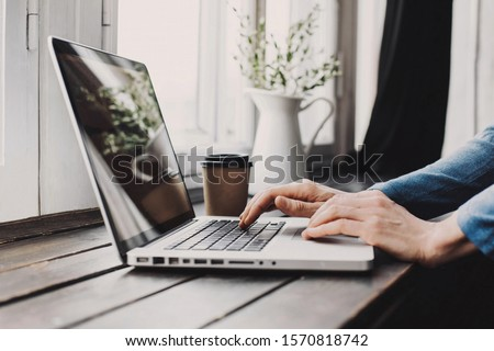 Men working on computer at home. Businessman using laptop in the office or at cafe. Business, home work, online learning, marketing, freelance, studying concept. Distance education #1570818742