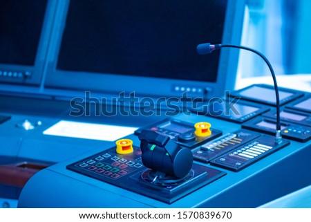 Place to control the ship. Captain's bridge. Helm of a modern ship. Place of the captain of the ship. Concept - control of a marine vessel. Microphone on the captain?s bridge. Yacht management #1570839670