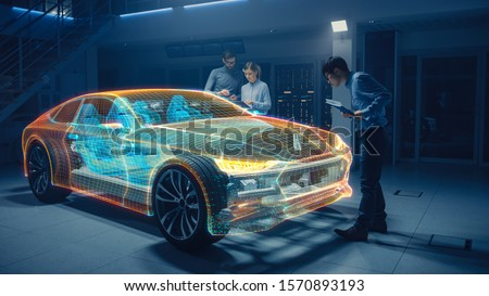Group of Automobile Design Engineers Working in Virtual Reality 3D Model Prototype of Electric Car Chassis. Automotive Innovation Facility: 3D Concept Vehicle Generated with 3D CAD Software. #1570893193