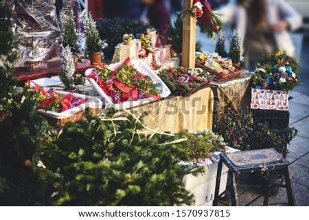sale of a variety of festive compositions of evergreens at the Christmas market. #1570937815