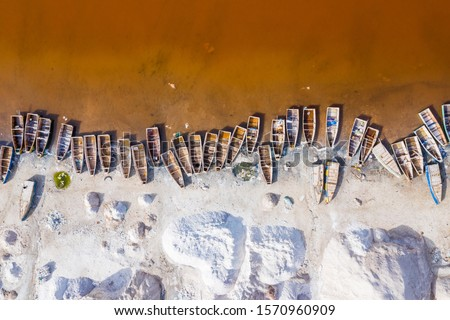 Aerial view of the Pink Lake Retba or Lac Rose in Senegal. Photo made by drone from above. Africa Natural Landscape. #1570960909