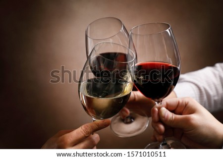 Hands of men and women toasting with wine glasses #1571010511