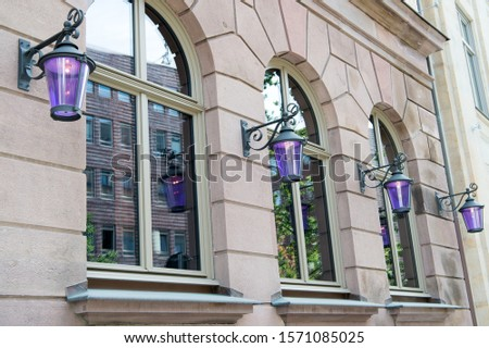 Wanderlust and city dust. Old building architecture. House facade with windows and lanterns. Architectural structure. Building and architecture. Town architecture. Architecture and urban development. #1571085025