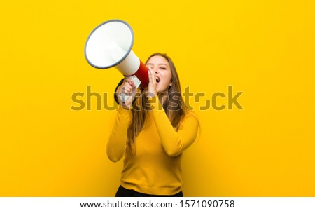 young pretty woman with a megaphone #1571090758