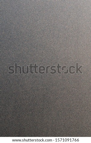 Closeup of the surface of the facing tile on the facade of the building, made of small multicolored shiny grain. Abstract, trendy, modern, texture background with copy space. #1571091766