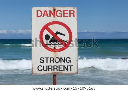 Dangerous currents sign at Bondi Beach in Sydney, Australia #1571095165