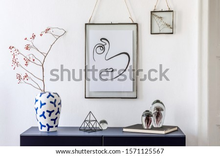 Stylish scandinavian living room with mock up poster frame, navy blue commode, japan vase with flowers and elegant accessories. Modern home decor. Interior design. Template Ready to use.