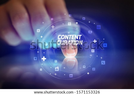 Finger touching tablet with social media icons and CONTENT CURATION