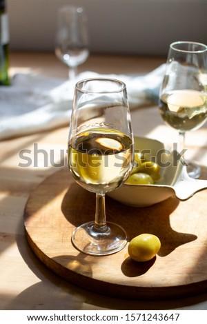 Sherry wine tasting, dry fino, manzanilla or palomino jerez fortified wine in glasses, Jerez de la Frontera, Andalusia, Spain close up #1571243647