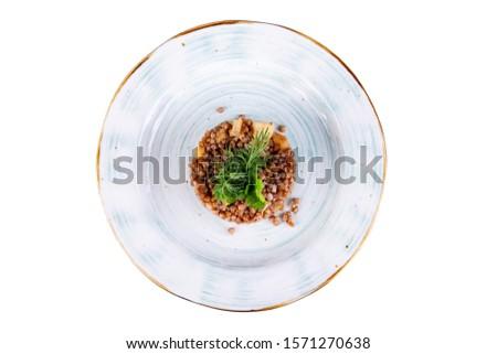 Garnish buckwheat with onion.Garnish buckwheat with onion #1571270638