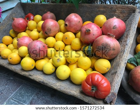 fruits and vegetables conceptual buying photo shoot at the grocery store contrasting fruit composition shooting different alternative compositions in wood and wicker.  #1571272534