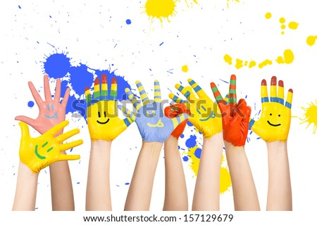 painted children's hands in different colors with smilies #157129679