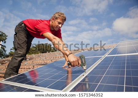 Photovoltaic installation on roof in Landshut, Bayern, Germany #1571346352