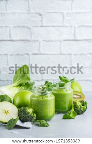 Food and drink, healthy dieting and nutrition, lifestyle, vegan, alkaline, vegetarian concept. Green smoothie with organic ingredients, vegetables on a modern kitchen table. Copy space background #1571353069