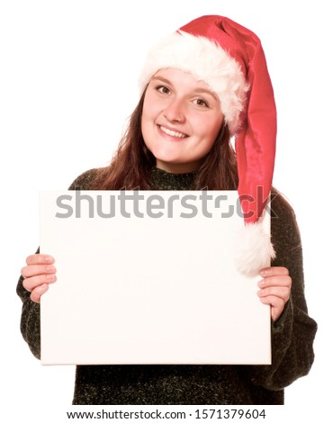 Woman with a Christmas hat holding an empty banner #1571379604