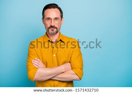 Portrait of concentrated man true chief cross hands feel strict wear stylish clothing isolated over blue color background #1571432710