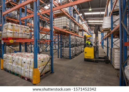 Canary islands, Spain - november 14, 2013: Operator working with a forklift inside a chemical store on the island of Tenerife #1571452342