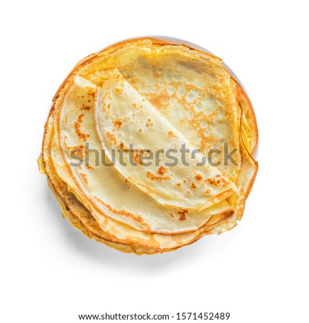 Crepes (Russian Blini) isolated on white background, top view. Homemade thin crepes for breakfast or dessert. Royalty-Free Stock Photo #1571452489