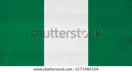 A rustic old Nigeria flag on weathered wood for a background #1571486104