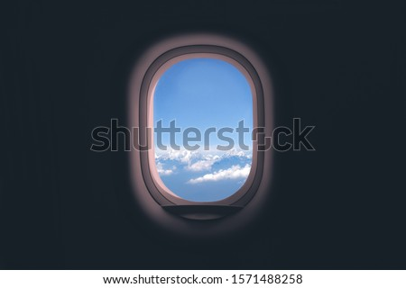 Airplane window. Mountain and clouds view #1571488258