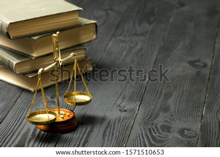 Law concept - Open law book with a wooden judges gavel on table in a courtroom or law enforcement office isolated on white background. Copy space for text. #1571510653